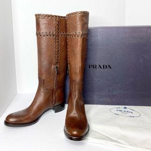 Prada 'Rodeo Calf' Knee High Grommet Leather Boots